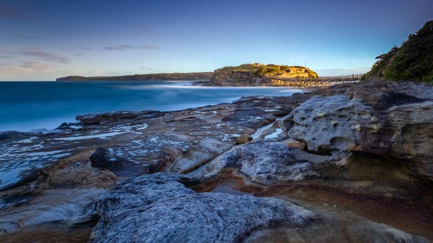 outdoor water beach landscape sky rock nature mountain