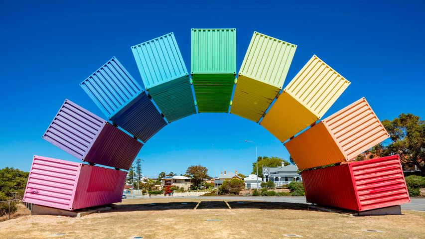 Wide angle view of rainbow-coloured shipping containers in Fremantle, Australia